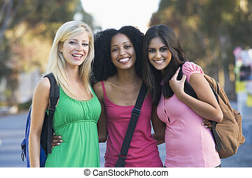 Group of female students having fun - Group of three female...