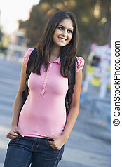University student wearing rucksack - Female student wearing...