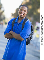 University student wearing rucksack - Male student wearing...