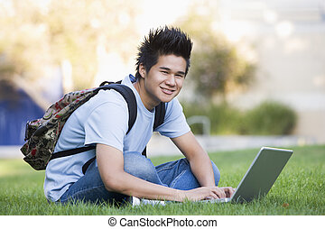 University student with laptop computer - Male student...