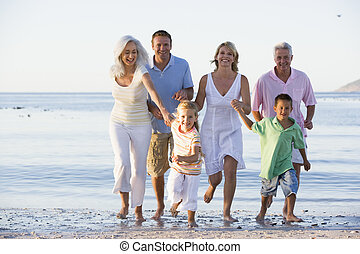 Extended family walking on beach
