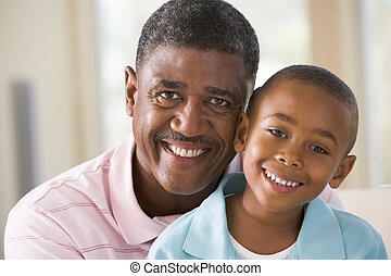Grandfather and grandson indoors smiling