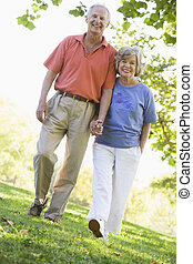 Senior couple on walk in countryside