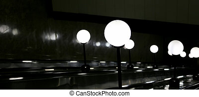 The lamp in the shape of a ball on an escalator metro , Moscow, Russia