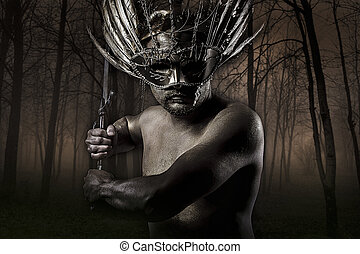 Golden Warrior in a forest, holding a huge sword in his...