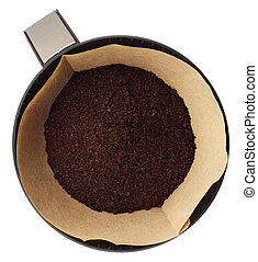 Ground coffee in filter holder isolated on white background...