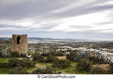Atalaya watchtower and greenhouses in background, Nijar -...