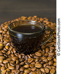 Coffee Beans, Cup on Dark Background