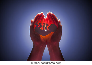 embryo silhouette in woman hand