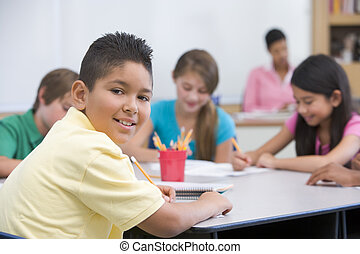 Elementary school pupil in classroom - Male elementary...