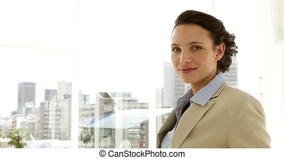Smiling businesswoman giving thumbs up in the office