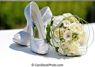 beautiful bouquet of roses and wedding shoes - beautiful...