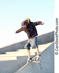 Urban lifestyle - Happy Young teenager skate boarding