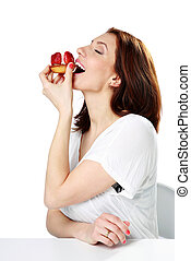 Woman eating fresh strawberry cake isolated on a white...