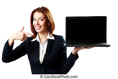 Happy businesswoman holding laptop and pointing on it...