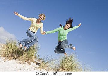 Two young women having fun at beach