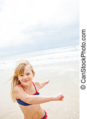 Young girl having fun at beach - Smiling happy cute young...