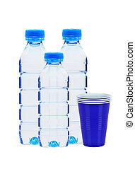 Blue bottles with water and plastic cups isolated on white...