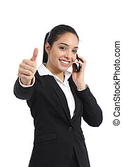 Arab business woman calling on the phone and thumb up