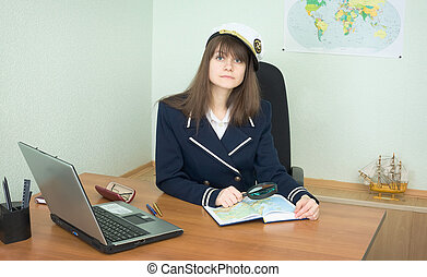 Girl - the sea captain with a atlas in office
