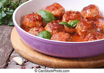 meatballs with tomato sauce in a pan - hot fresh meatballs...