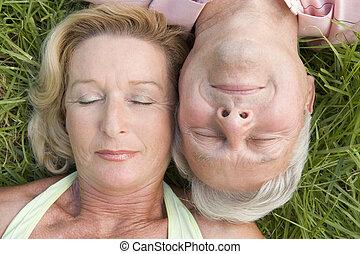 Couple sleeping outdoors