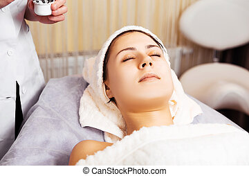 skin care, female relaxing after applying face mask cream