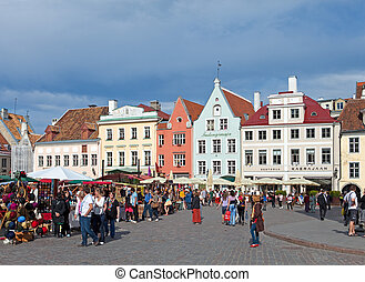 A crowd of tourists visit Town hall square in exhibition day...