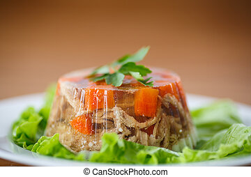 meat aspic - jellied meat with lettuce on a plate