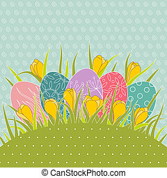 Easter eggs in grass and yellow crocuses