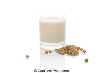 Soy milk. - Soy milk in glass with soya beans isolated on...