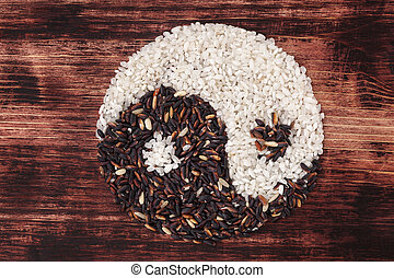 Black and white rice forming a yin yang symbol - White and...