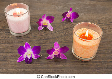 Orchid flowers and candles - Purple orchid flowers facing...