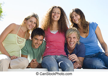 Five people on balcony smiling