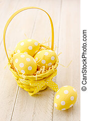 Easter Eggs and Baskets - Yellow Easter basket filled with...