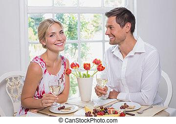 Happy couple with wine glasses havi