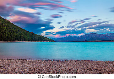 Lake Tekapo - Beautiful dramatic sunset over the incredibly...