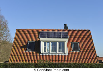 Solar panels on the roof of a single family house