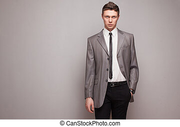 Fashionable man in grey suit
