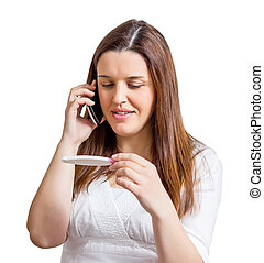 Woman with pregnancy test and talking by phone - Happy woman...
