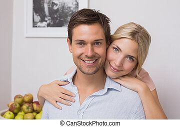 Woman embracing man from behind at