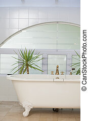 Contemporary bathroom interior with tub and tiled wall