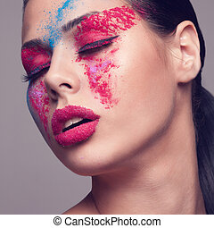 Beauty shot of fashionable women face with pink, red and blue dry colours. red glitters on lips. Square