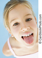 Young girl sticking her tongue out