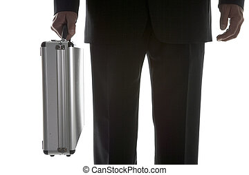 Businessman Holding Sturdy Silver Suitcase