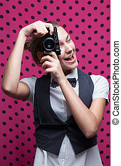 Funny face of young woman photographer