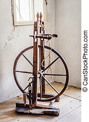 Old spinning wheel in a room of an austrian farm