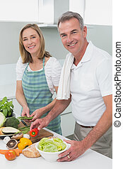 Happy couple preparing food togethe - Portrait of a happy...
