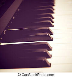 Close up of piano keys with retro filter effect