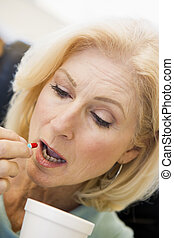 Woman Swallowing Pill